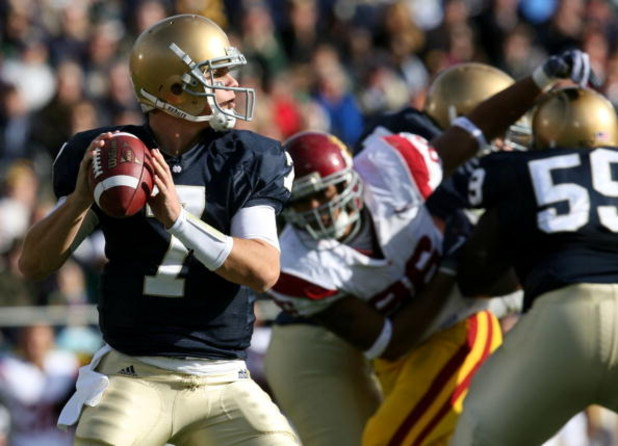 SOUTH BEND, IN - OCTOBER 17: Quarterback Jimmy Clausen #7 of the Notre Dame Fighting Irish looks to pass the ball against the USC Trojans in the first quarter of the game at Notre Dame Stadium on October 17, 2009 in South Bend, Indiana. (Photo by Jonathan