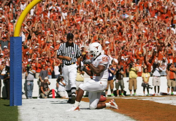 DALLAS - OCTOBER 7:  Running back Selvin Young #22 of the Texas Longhorns kneels in the endzone after scoring a touchdown against the Oklahoma Sooners during the Red River Shootout at the Cotton Bowl on October 7, 2006 in Dallas, Texas. The Longhorns won