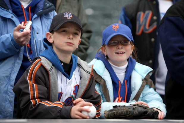 NEW YORK - APRIL 04:  Two young Mets fans watch batting practice before the New York Mets game against the Boston Red Sox on April 4, 2009 at Citi Field in the Flushing neighborhood of the Queens borough of New York City.  (Photo by Ezra Shaw/Getty Images