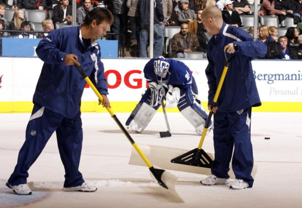 TORONTO - OCTOBER 17: Ice Crews clean the ice around Joey MacDonald #29 of the Toronto Maple Leafs during a game against the New York Rangers during a NHL game at the Air Canada Centre on October 17, 2009 in Toronto, Ontario, Canada . (Photo by Abelimages