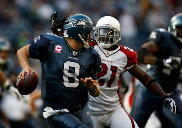SEATTLE, WA - OCTOBER 18:  Quarterback Matt Hasselbeck #8 of the Seattle Seahawks is pressured by Antrel Rolle #21 of the Arizona Cardinals at Qwest Field on October 18, 2009 in Seattle, Washington.  (Photo by Jonathan Ferrey/Getty Images)