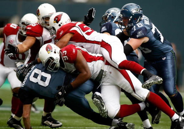 SEATTLE, WA - OCTOBER 18:  Quarterback Matt Hasselbeck #8 of the Seattle Seahawks is sacked by Calais Campbell #93 of the Arizona Cardinals at Qwest Field on October 18, 2009 in Seattle, Washington.  (Photo by Jonathan Ferrey/Getty Images)
