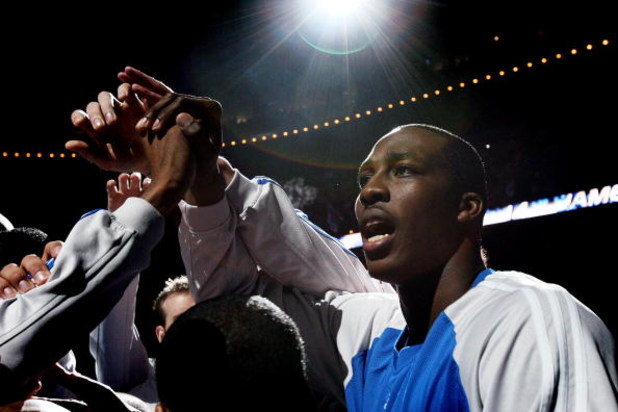 ORLANDO, FL - MAY 07: Dwight Howard #12 of the Orlando Magic tries to get his team ready to face the Detroit Pistons in Game Three of the Eastern Conference Semifinals during the 2008 NBA Playoffs at the Amway Arena on May 7, 2008 in Orlando, Florida. NOT