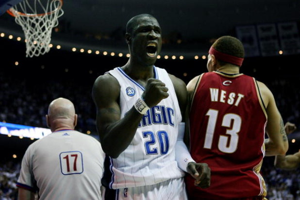 ORLANDO, FL - MAY 24:  Mickael Pietrus #20 of the Orlando Magic celebrates drawing a sixth foul from Delonte West #13 of the Cleveland Cavaliers in Game Three of the Eastern Conference Finals during the 2009 NBA Playoffs at the the Amway Arena on May 24,