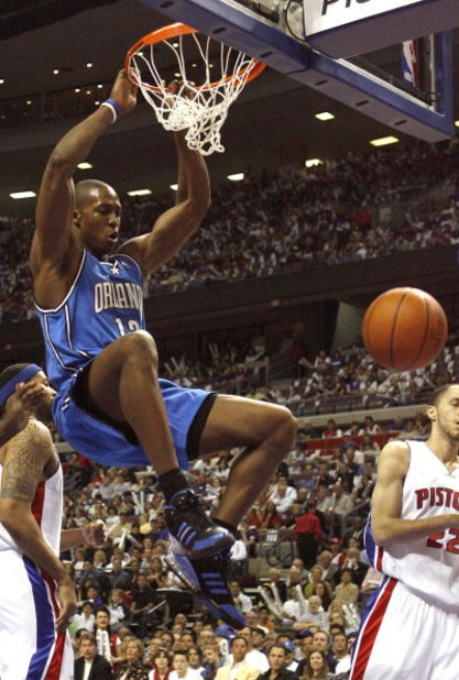 AUBURN HILLS, MI - APRIL 21:  Dwight Howard #12 of the Orlando Magic dunks in front of Tayshaun Prince #22 and Rasheed Wallace #36 of the Detroit Pistons in game one of the Eastern Conference Quarterfinals during the 2007 NBA Playoffs at the Palace of Aub