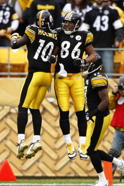 PITTSBURGH, PA - OCTOBER 18: Hines Ward #86 of the Pittsburgh Steelers celebrates with Santonio Holmes #10 after a first half touchdown against the Cleveland Browns at Heinz Field on October 18, 2009 in Pittsburgh, Pennsylvania. (Photo by Joe Robbins/Gett