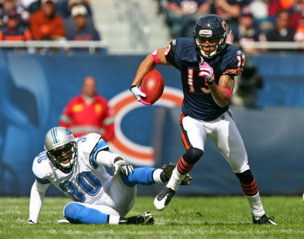 CHICAGO - OCTOBER 04: Johnny Knox #13 of the Chicago Bears runs past Ko Simpson #30 of the Detroit Lions on October 4, 2009 at Soldier Field in Chicago, Illinois. The Bears defeated the Lions 48-24. (Photo by Jonathan Daniel/Getty Images)