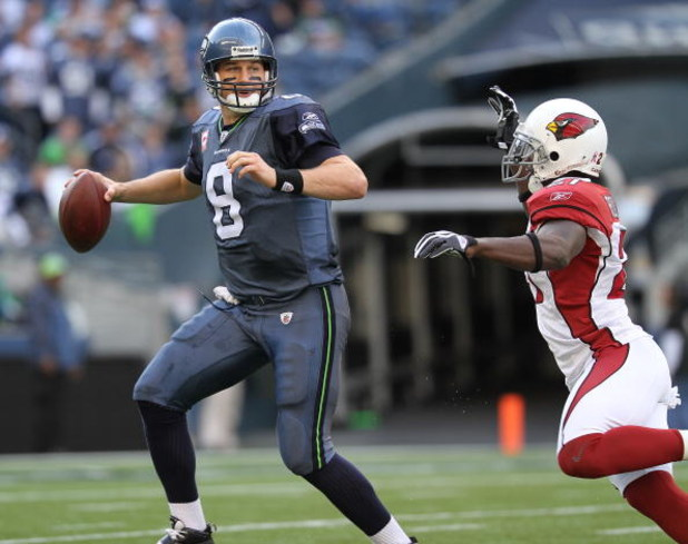 SEATTLE - OCTOBER 18: Quarterback Matt Hasselbeck #8 of the Seattle Seahawks scrambles against Antrel Rolle #21 of the Arizona Cardinals on October 18, 2009 at Qwest Field in Seattle, Washington. The Cardinals defeated the Seahawks 27-3. (Photo by Otto Gr