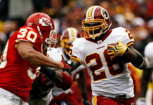 LANDOVER, MD - OCTOBER 18:  Mike Brown #30 of the Kansas City Chiefs tackles Clinton Portis #26 of the Washington Redskins during their game October 18, 2009 at FedEx Field in Landover, Maryland.The Chiefs won the game 14-6.  (Photo by Win McNamee/Getty I