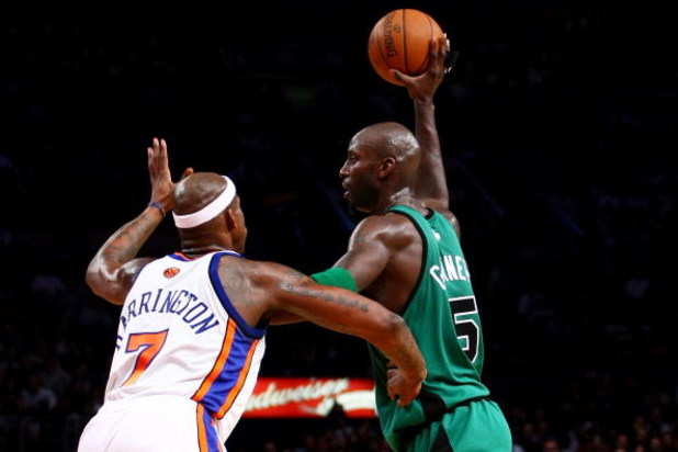 NEW YORK - FEBRUARY 06:  Kevin Garnett #5 of the Boston Celtics holds off Al Harrington #7 of the New York Knicks at Madison Square Garden February 6, 2009 in New York City. NOTE TO USER: User expressly acknowledges and agrees that, by downloading and/or