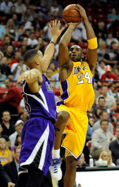 LAS VEGAS - OCTOBER 15:  Kobe Bryant #24 of the Los Angeles Lakers shoots over Kevin Martin #23 of the Sacramento Kings during their preseason game at the Thomas & Mack Center October 15, 2009 in Las Vegas, Nevada. NOTE TO USER: User expressly acknowledge