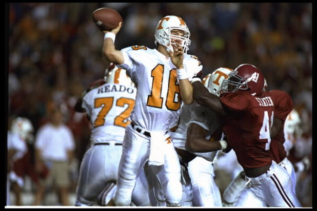 14 OCT 1995:  TENNESSEE QUARTERBACK PEYTON MANNING THROWS THE FOOTBALL AS PRESSURE IS APPLIED DURING THE VOLUNTEERS 41-14 VICTORY OVER THE ALABAMA CRIMSON TIDE AT LEGION FIELD IN BIRMINGHAM, ALABAMA.  Mandatory Credit:  Al Bello/Allsport