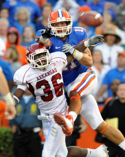 GAINESVILLE, FL - OCTOBER 17: Cornerback Andru Stewart #36 of the Arkansas Razorbacks breaks up a pass to wide receiver Riley Cooper #11 of the Florida Gators October 17, 2009 at Ben Hill Griffin Stadium in Gainesville, Florida.  (Photo by Al Messerschmid