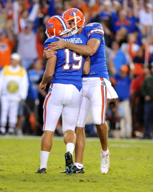 GAINESVILLE, FL - OCTOBER 17: Kicker Caleb Sturgis #19 and holder Chas Henry #17 of the Florida Gators celebrate a game-winning 27-yard field goal against the University of Arkansas Razorbacks October 17, 2009 at Ben Hill Griffin Stadium in Gainesville, F