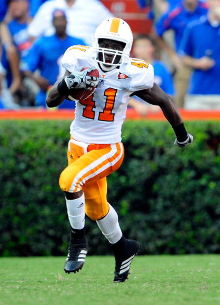GAINESVILLE, FL - SEPTEMBER 19:  Dennis Rogan #41 of the Tennessee Volunteers runs for yardage during the game against the Florida Gators at Ben Hill Griffin Stadium on September 19, 2009 in Gainesville, Florida.  (Photo by Sam Greenwood/Getty Images)