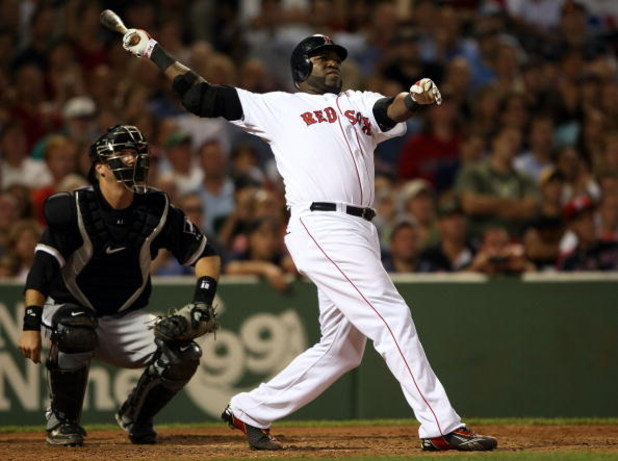 BOSTON - AUGUST 26:  David Ortiz #34 of the Boston Red Sox hits a solo home run at the bottom of the 9th inning to win the game as catcher A.J. Pierzynski #23 of the Chicago White Sox defends on August 26, 2009 at Fenway Park in Boston, Massachusetts. The
