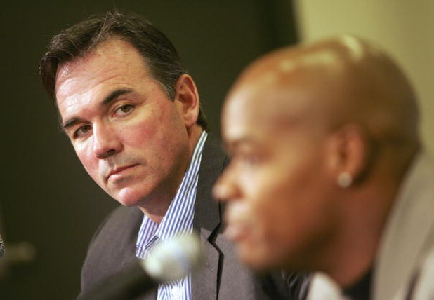 OAKLAND, CA - JANUARY 26:  General manager Billy Beane (L) of the Oakland Athletics listens to Frank Thomas speak during a press conference, after Thomas signed a one-year contract with the team, at McAfee Coliseum on January 26, 2006 in Oakland, Californ