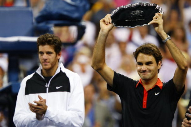 NEW YORK - SEPTEMBER 14:  (L-R) Juan Martin Del Potro of Argentina and Roger Federer of Switzerland pose with their trophies after the Men's Singles final on day fifteen of the 2009 U.S. Open at the USTA Billie Jean King National Tennis Center on Septembe