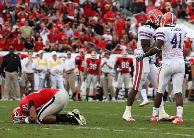 JACKSONVILLE, FL - NOVEMBER 01:  Split end Kenneth Harris #88 of the Georgia Bulldogs reacts after missing a wide open catch in front of linebackers Ryan Stamper #41 and Brandon Spikes #51 of the Florida Gators at Jacksonville Municipal Stadium on Novembe