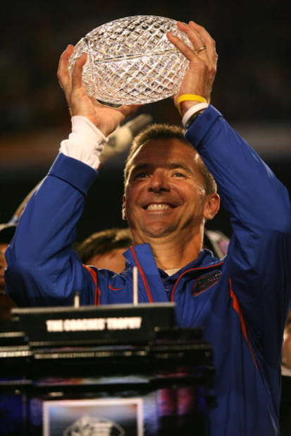 MIAMI - JANUARY 08:  Head coach Urban Meyer of the Florida Gators celebrates with the National Championship trophy after their 24-14 win against the Oklahoma Sooners during the FedEx BCS National Championship game at Dolphin Stadium on January 8, 2009 in