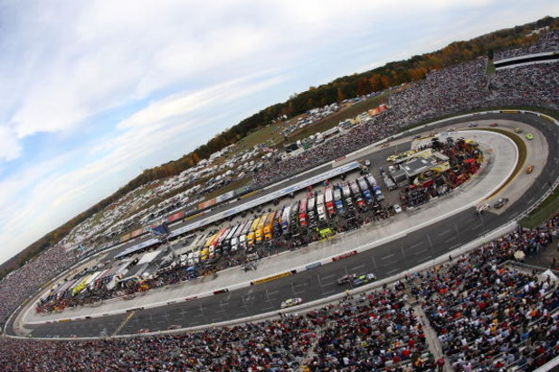 MARTINSVILLE, VA - OCTOBER 25:  Cars race around turns 1 and 2 during the NASCAR Sprint Cup Series TUMS Fast Relief 500 at Martinsville Speedway on October 25, 2009 in Martinsville, Virginia.  (Photo by Streeter Lecka/Getty Images)