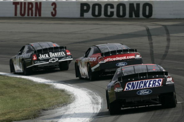 LONG POND, PA - JUNE 10:  Ricky Rudd, driver of the #88 Snickers Ford, follows behind Carl Edwards, driver of the #99 Office Depot Ford, and Clint Bowyer, driver of the #07 Jack Daniel's Chevrolet, during the NASCAR Nextel Cup Series Pocono 500 at Pocono