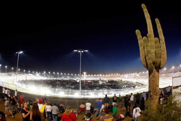 AVONDALE, AZ - APRIL 18: A general view of cars racing during the NASCAR Sprint Cup Series SUBWAY Fresh Fit 500 at Phoenix International Raceway on April 18, 2009 in Avondale, AZ.  (Photo by Chris Graythen/Getty Images for NASCAR)