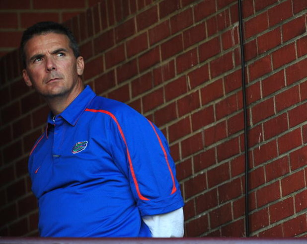 STARKVILLE, MS - OCTOBER 24:  Head coach Urban Meyer of the University of Florida Gators, during pre game warmup up against the Mississippi State Bulldogs, at Davis Wade Stadium on  October 24, 2009 in Starkville, Mississippi  (Photo by Rick Dole/Getty Im