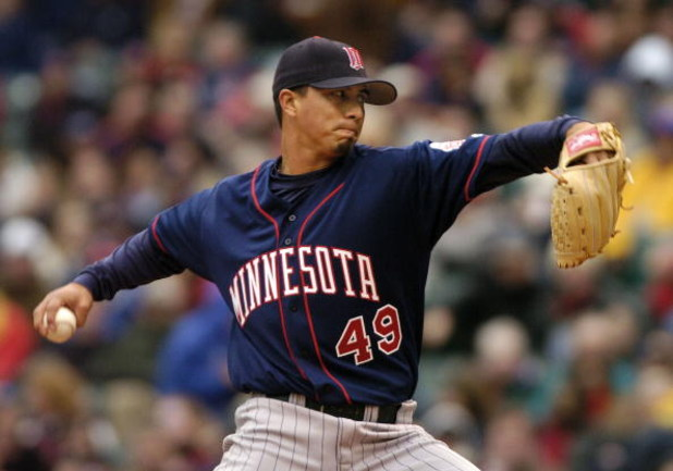 CLEVELAND - APRIL 12:  Kyle Lohse #49 of the Minnesota Twins delivers a pitch to the Cleveland Indians on April 12, 2004 at Jacobs Field in Cleveland, Ohio. Cleveland defeated Minnesota 6-3 in their home opener.  (Photo by David Maxwell/Getty Images)
