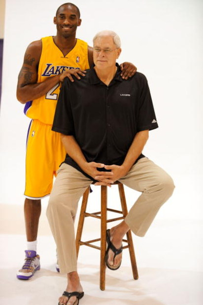EL SEGUNDO, CA - SEPTEMBER 29:  Kobe Bryant #24 and Phil Jackson coach of the Los Angeles Lakers pose for a photograph during Lakers media day at their training facility on  September 29, 2009 in El Segundo, California. NOTE TO USER: User expressly acknow
