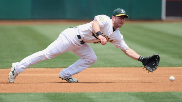OAKLAND - JULY 10:  Jack Hannahan #22 of the Oakland Athletics leaps for the ball against the Seattle Mariners during a Major League Baseball game on July 10, 2008 at McAfee Coliseum in Oakland, California. (Photo by: Jed Jacobsohn/Getty Images)