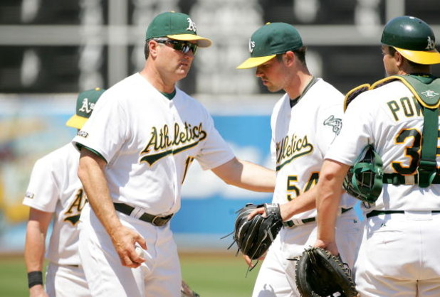 OAKLAND, CA - JUNE 28:  Manager Bob Geren takes out Vin Mazzaro #54 of the Oakland Athletics in the sixth inning of their game against the Colorado Rockies at the Oakland Coliseum on June 28, 2009 in Oakland, California.  (Photo by Ezra Shaw/Getty Images)