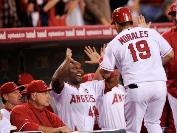 ANAHEIM, CA - APRIL 22:  Kendry Morales #19 of the Los Angeles Angels of Anaheim is congratulated by teammate Torii Hunter #48 after hitting a three-run home run against the Detroit Tigers during the first inning of the baseball game at Angel Stadium on A