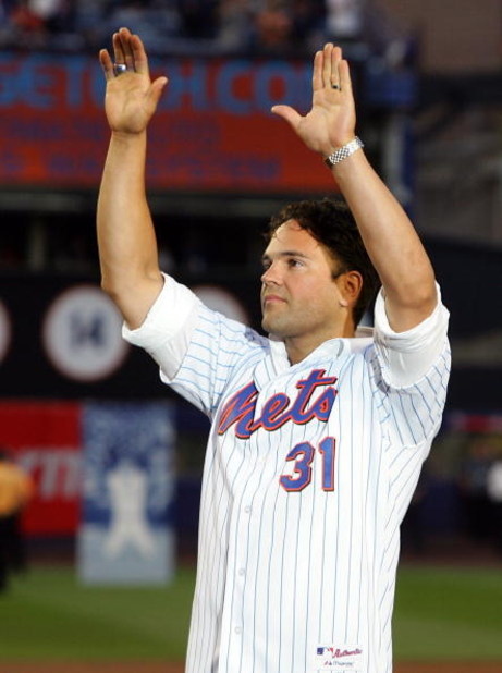 NEW YORK - SEPTEMBER 28: Former New York Met Mike Piazza waves to the crowd during post game ceremoies after the Mets played the Florida Marlins in the last regular season baseball game ever played in Shea Stadium on September 28, 2008 in the Flushing nei