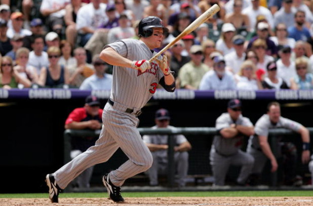 DENVER - MAY 18:  First baseman Justin Morneau #33 of the Minnesota Twins takes an at bat against the Colorado Rockies during Interleague MLB action at Coors Field on May 18, 2008 in Denver, Colorado. The Rockies defeated the Twins 6-2.  (Photo by Doug Pe