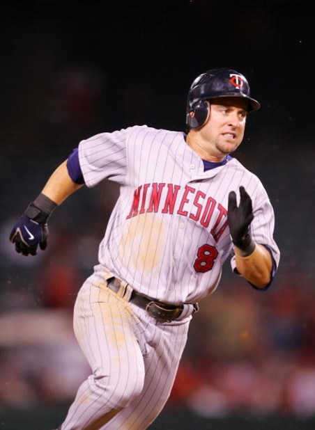 ANAHEIM, CA - AUGUST 21:  Nick Punto #8 of the Minnesota Twins runs to third base after hitting a triple in the 12th inning against the Los Angeles Angels of Anaheim at Angels Stadium on August 21, 2008 in Anaheim, California.  (Photo by Lisa Blumenfeld/G