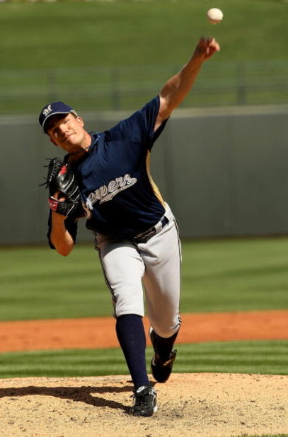 SURPRISE, AZ - MARCH 5: Pitcher Manny Parra #43 of the Milwaukee Brewers throws a pitch against the Texas Rangers on March 5, 2008 at Surprise Stadium in Surprise, Arizona.   (Photo by Stephen Dunn/Getty Images)