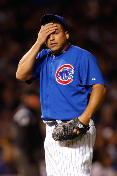 CHICAGO - OCTOBER 02:  Carlos Zambrano #38 of the Chicago Cubs wipes his forehead in the top of the second inning against the Los Angeles Dodgers in Game Two of the NLDS during the 2008 MLB Playoffs at Wrigley Field on October 2, 2008 in Chicago, Illinois