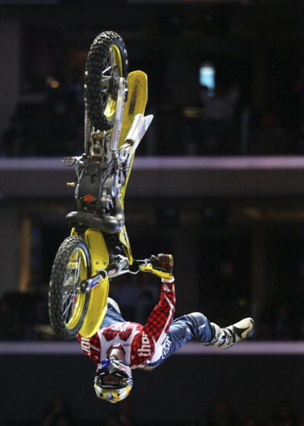 LOS ANGELES - AUGUST 4:  Travis Pastrana completes his first run in the Moto X Best Trick Final during the ESPN X Games on August 4, 2006 at the Staples Center in Los Angeles, California. Pastrana completed a double back flip on his second attempt and won
