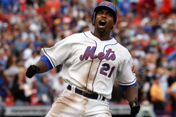 NEW YORK - SEPTEMBER 28:  Carlos Delgado #21 of the New York Mets reacts after flying out in the eighth inning against the Florida Marlins during the last regular season baseball game ever played in Shea Stadium on September 28, 2008 in the Flushing neigh