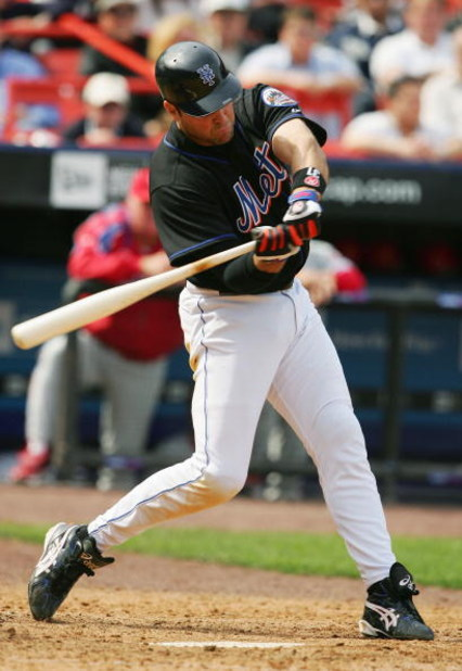 FLUSHING - MAY 5:  Mike Piazza #31 of the New York Mets hits a three run home run against the Philadelphia Phillies in the eighth inning during their game on May 5, 2005 at Shea Stadium in Flushing, New York. (Photo by Al Bello/Getty Images)