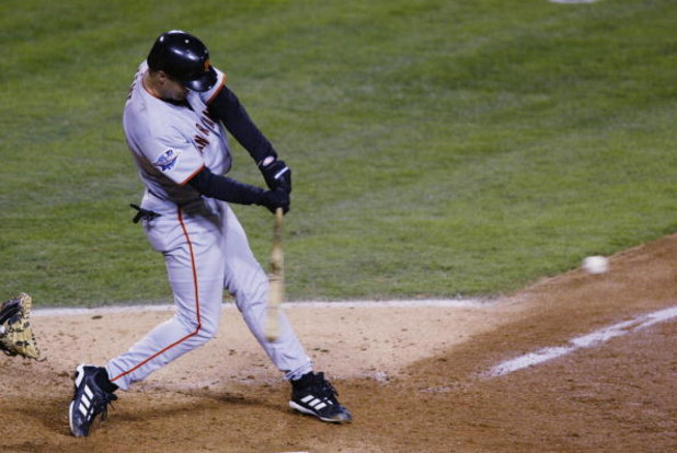 ANAHEIM, CA - OCTOBER 26:   Jeff Kent #21 of the San Francisco Giants hits an rbi single to score teammate Kenny Lofton #1 in the seventh inning of game six of the World Series on October 26, 2002 at Edison Field in Anaheim, California. (Photo by Donald M