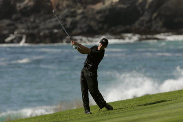 PEBBLE BEACH, CA - FEBRUARY 12:  Mike Weir hits a shot during the final round of the AT&T Pro Am on February 12, 2006 at the Pebble Beach Golf Links Golf Course in Pebble Beach, California.  (Photo by Stephen Dunn/Getty Images)