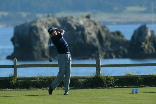PEBBLE BEACH, CA - FEBRUARY 9: Davis Love III hits off the 18th tee during the final round of the AT&T Pebble Beach National Pro-Am on February 9, 2003 at Pebble Beach Golf Links in Pebble Beach, California.  (Photo by Jeff Gross/Getty Images)