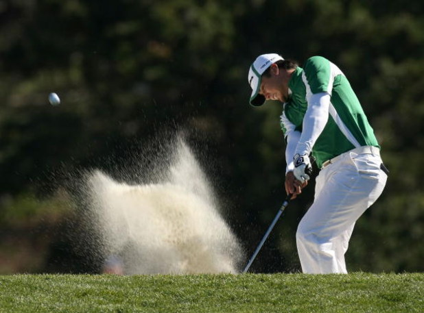 PEBBLE BEACH, CA - FEBRUARY 10: Jason Day hits out of a fairway bunker on the 13th hole during the final round of the AT&T Pebble Beach National Pro-Am on Pebble Beach Golf Links on February 10, 2008 in Pebble Beach. California.  (Photo by Stephen Dunn/Ge
