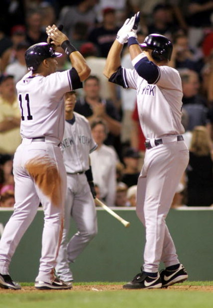 BOSTON - JULY 14:  Alex Rodriguez #13 of the New York Yankees high-fives teammate Gary Sheffield #11 at home after both scored on a two-run home run by Rodriguez in the ninth inning against the Boston Red Sox at Fenway Park on July 14, 2005 in Boston, Mas
