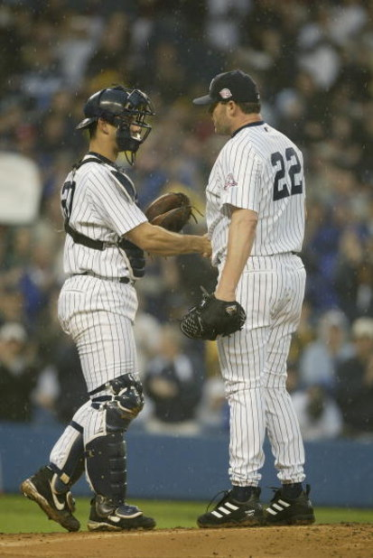BRONX, NY - JUNE 13:  Catcher Jorge Posada #20 of the New York Yankees congratulates pitcher Roger Clemens #22 after Clemens recorded his 4000th strikeout, which happened to be against shortstop Edgar Renteria #3 of the St. Louis Cardinals, during the int