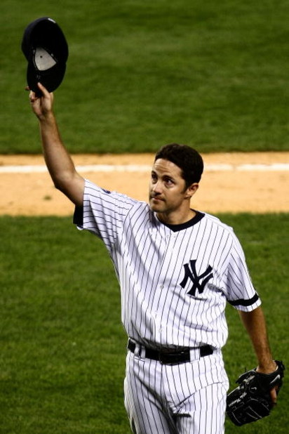 NEW YORK - SEPTEMBER 18:  Mike Mussina #35 of the New York Yankees waves to the crowd after being taken out of the game in the seventh inning against the Chicago White Sox on September 18, 2008 at Yankee Stadium in the Bronx borough of New York City.  (Ph