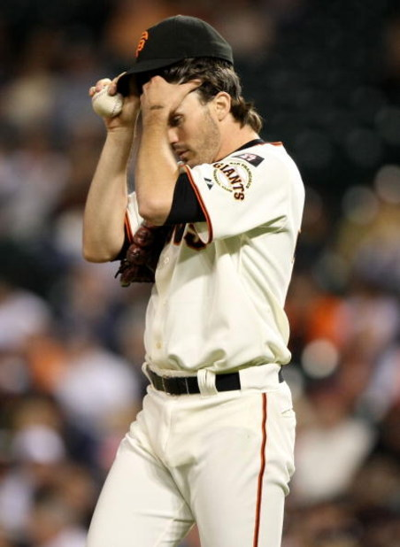 SAN FRANCISCO - SEPTEMBER 24:  Barry Zito #75 of the San Francisco Giants wipes his brow after giving up a run in the first inning against the San Diego Padres September 24, 2007 at AT&T Park in San Francisco, California.   (Photo by Jed Jacobsohn/Getty I