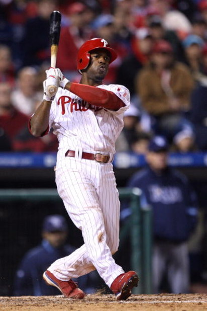 PHILADELPHIA - OCTOBER 25:  Jimmy Rollins #11 of the Philadelphia Phillies swings and misses against the Tampa Bay Rays during game three of the 2008 MLB World Series on October 25, 2008 at Citizens Bank Park in Philadelphia, Pennsylvania.  (Photo by Doug